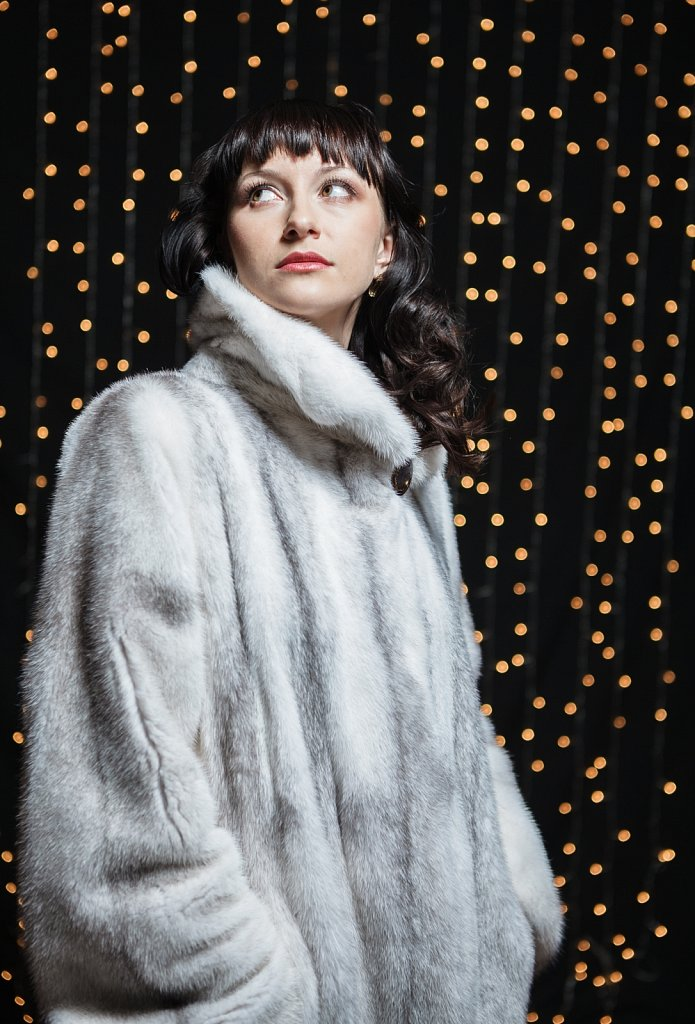 Portrait of beautiful young women in fur coat